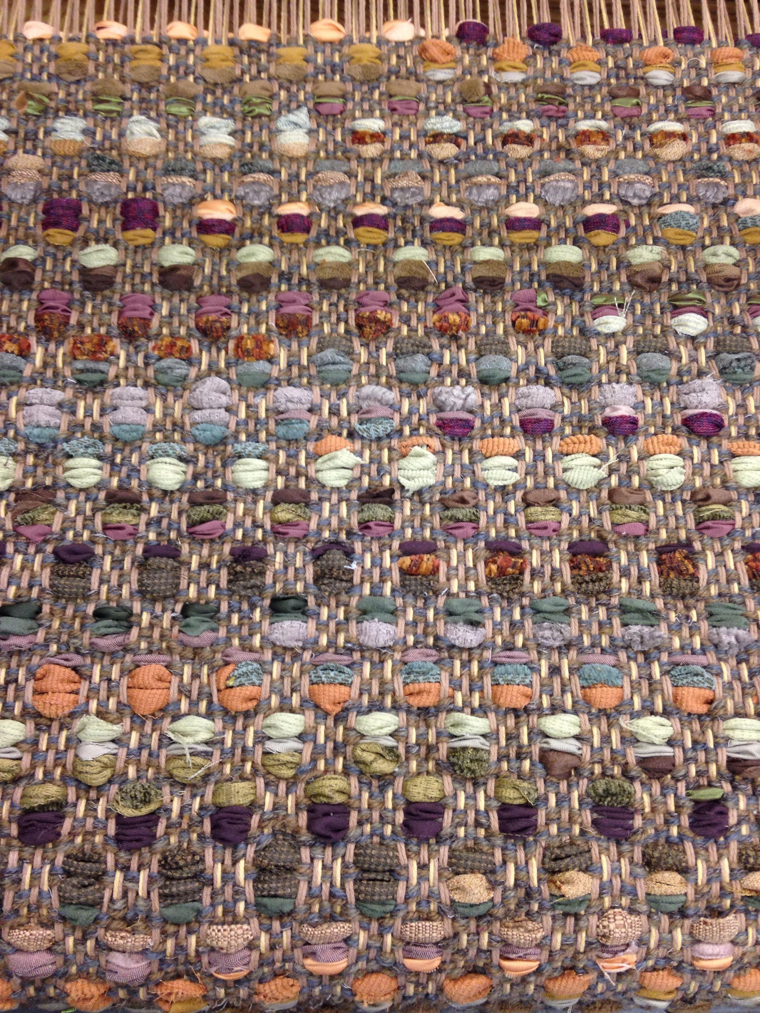 Mosaic flatweave rug with fabric.