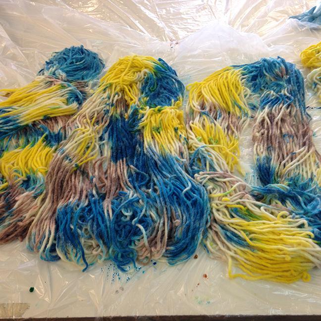 Hand painting the yarn