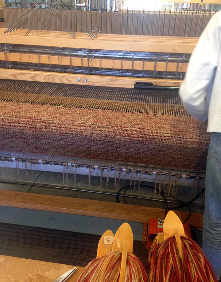 Meg weaving FW-14 at True North Textiles.