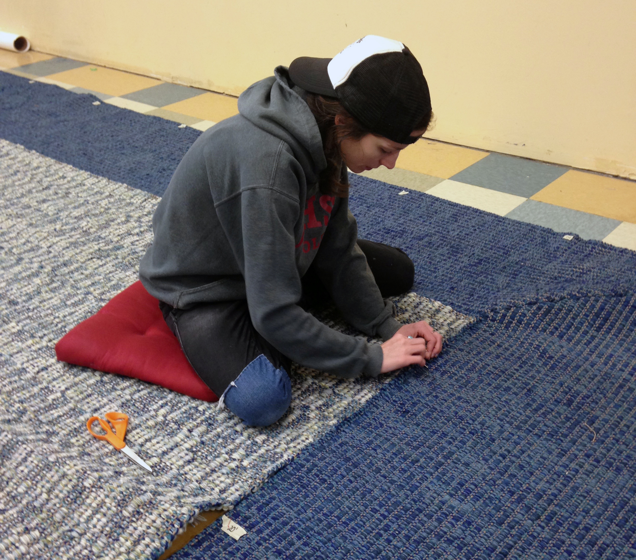 Meg seaming the border on the mitered-corner rug.