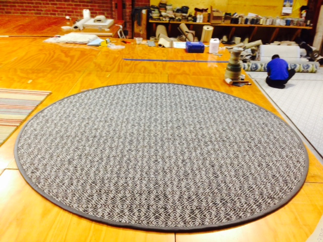 9-foot, round Creswell rug for Stark Carpet. This rug uses a leather binding instead of an application of rug yarn.