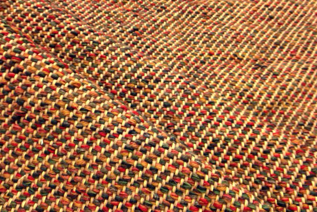 A change of weft from the golden threads in the previous image to the vibrant fall colors here make a world of different even though the two color palettes are similarly focused on yellow, orange, and blue.
