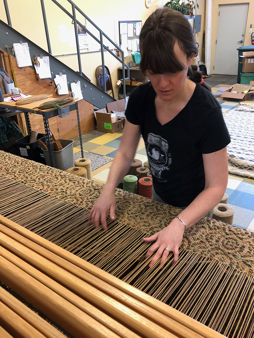 Cydni weaving the Ballard Den project.