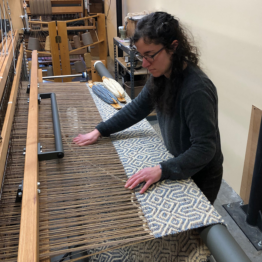 Michelle weaving the Steeple entry rug.
