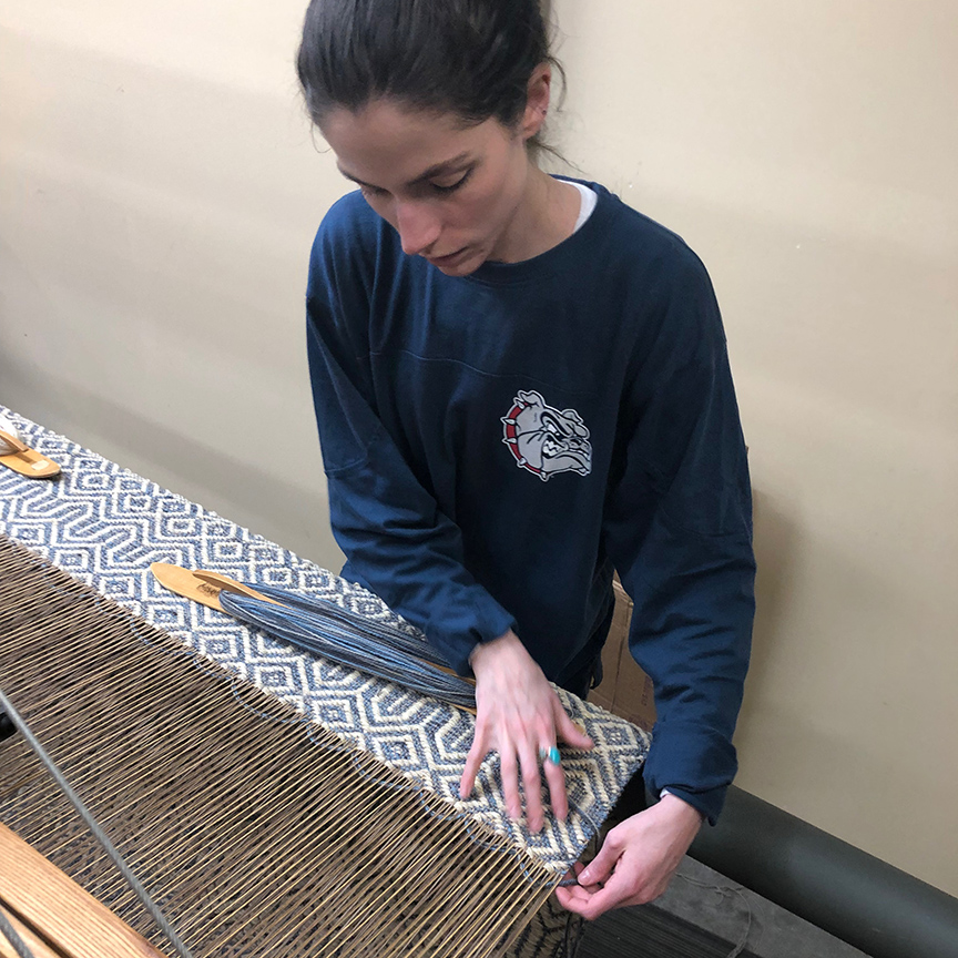 Meg weaving the Steeple entry rug.