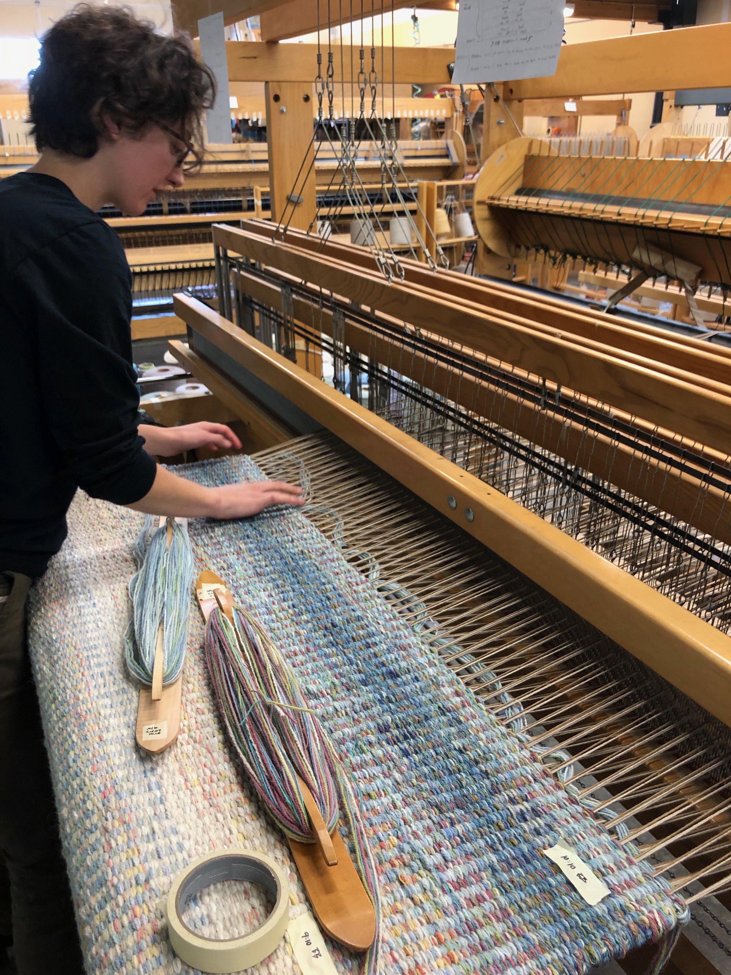 Brooke weaving a runner.