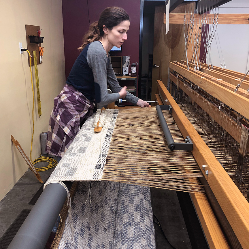 Meg weaving a custom color Runway.