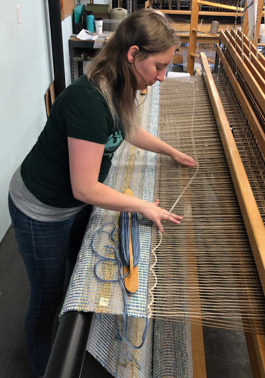 Meredith weaving at True North Textiles.