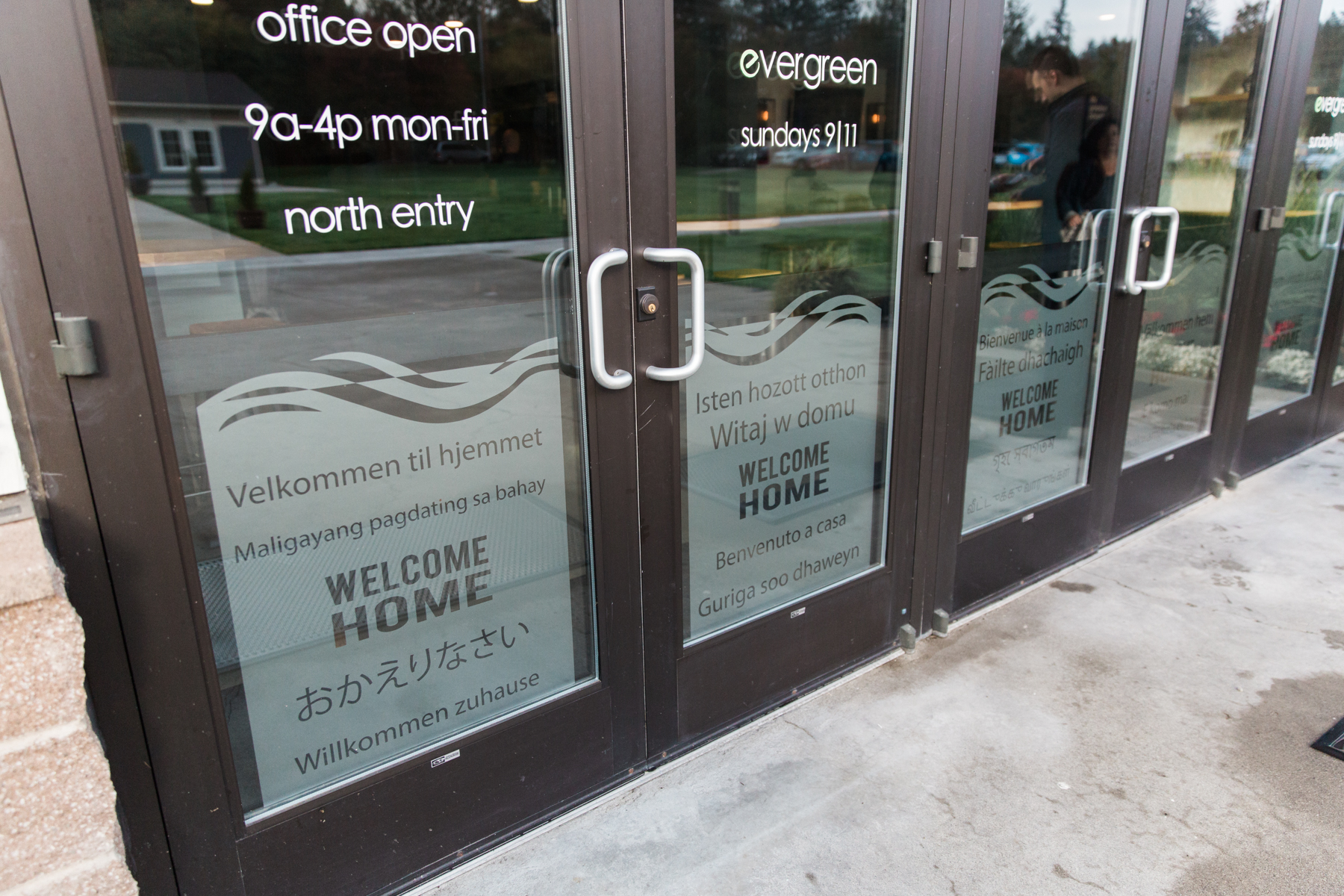 """Welcome Home"" is printed in 70 different languages across Evergreen's doors."