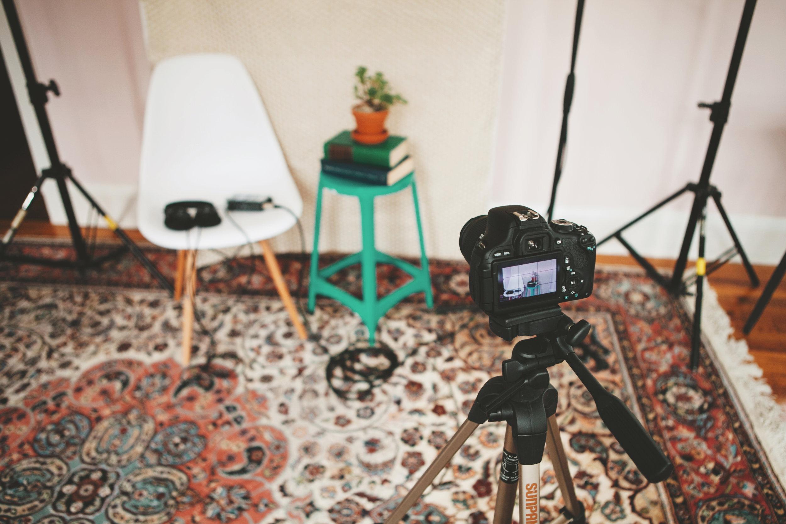 A video set with a Canon camera and backdrop