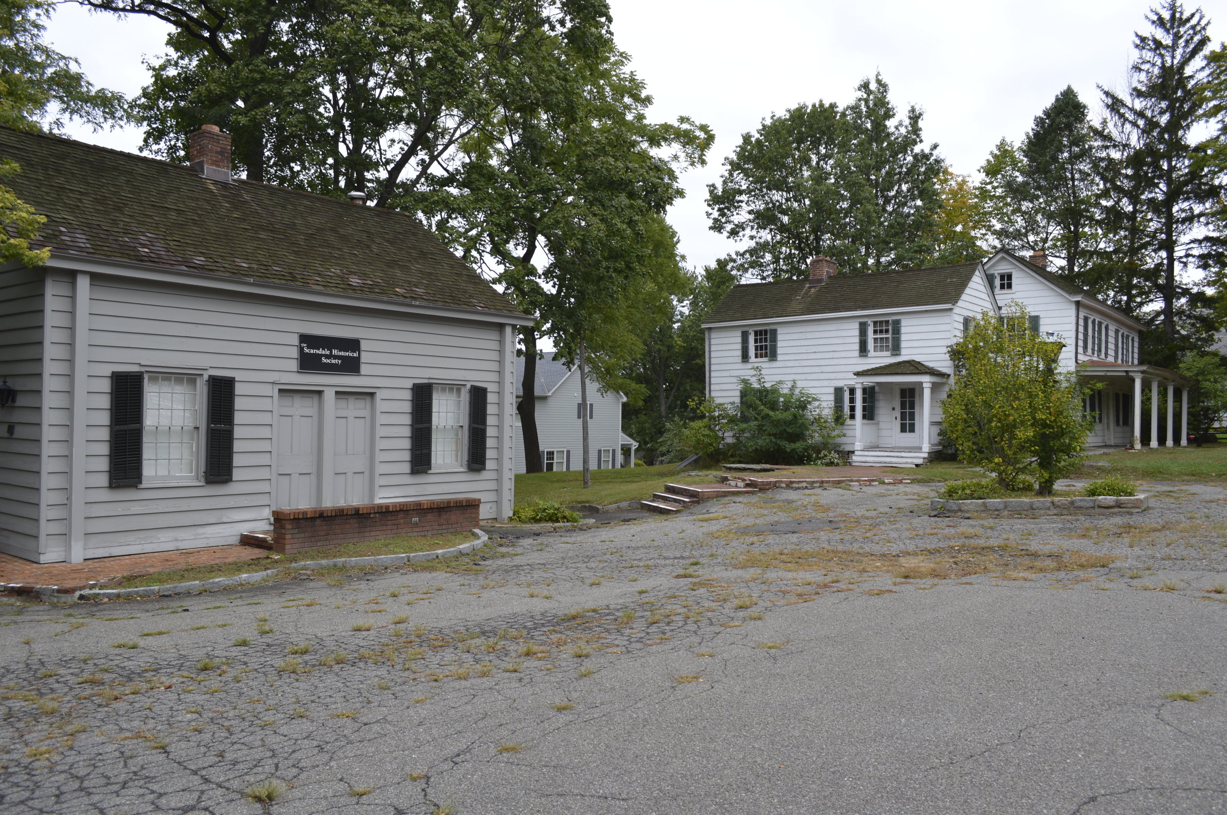 The Quaker Meeting House (left) was moved to the Cudner-Hyatt property in 1977.