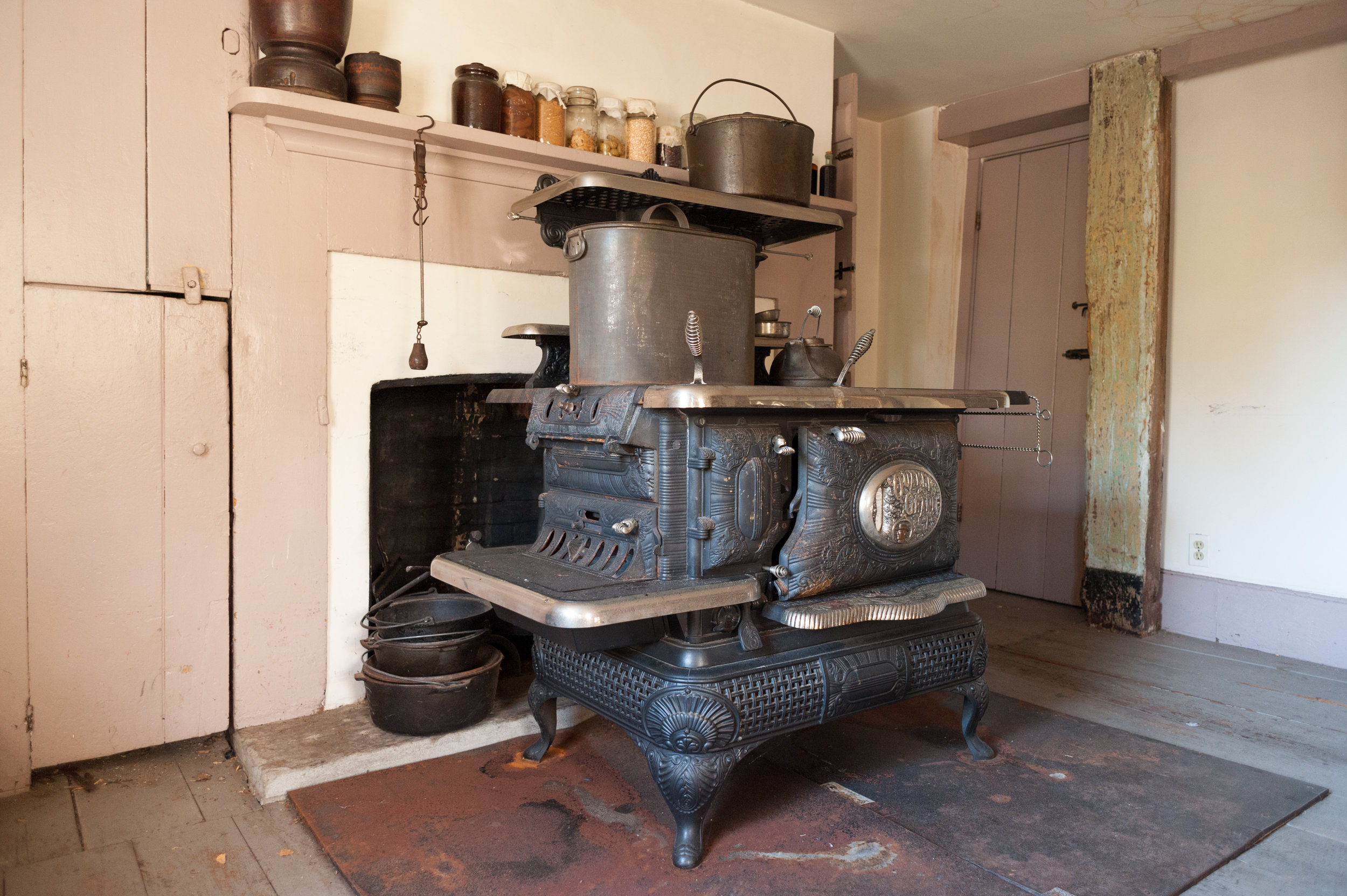 A cast iron wood burning stove was used for cooking and heating parts of the house.
