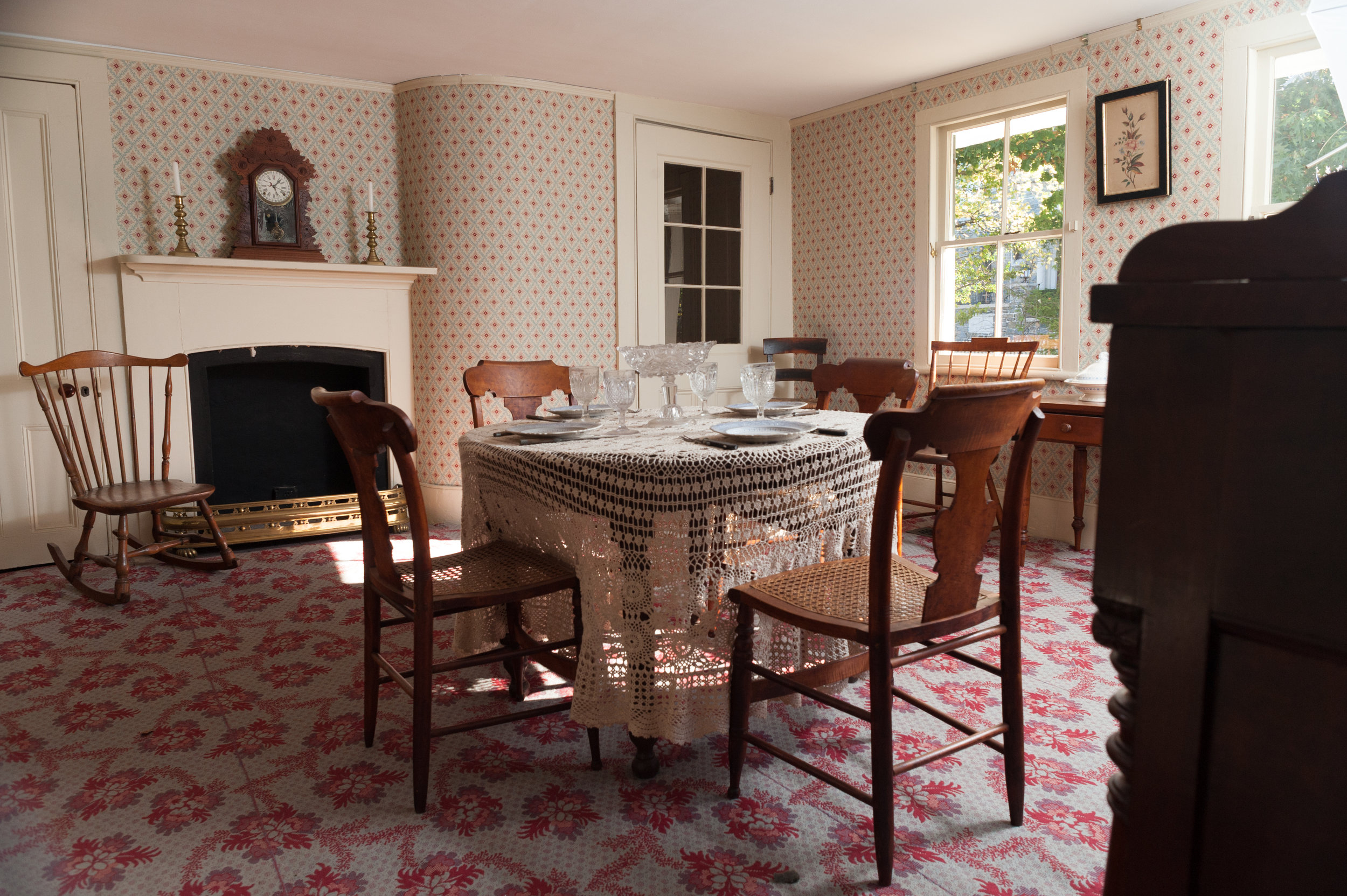 The wallpaper, paint colors, and carpets throughoutthe house were authentic reproductions of popular designs in the 19th century. The dining room carpet design is named Ballstone.