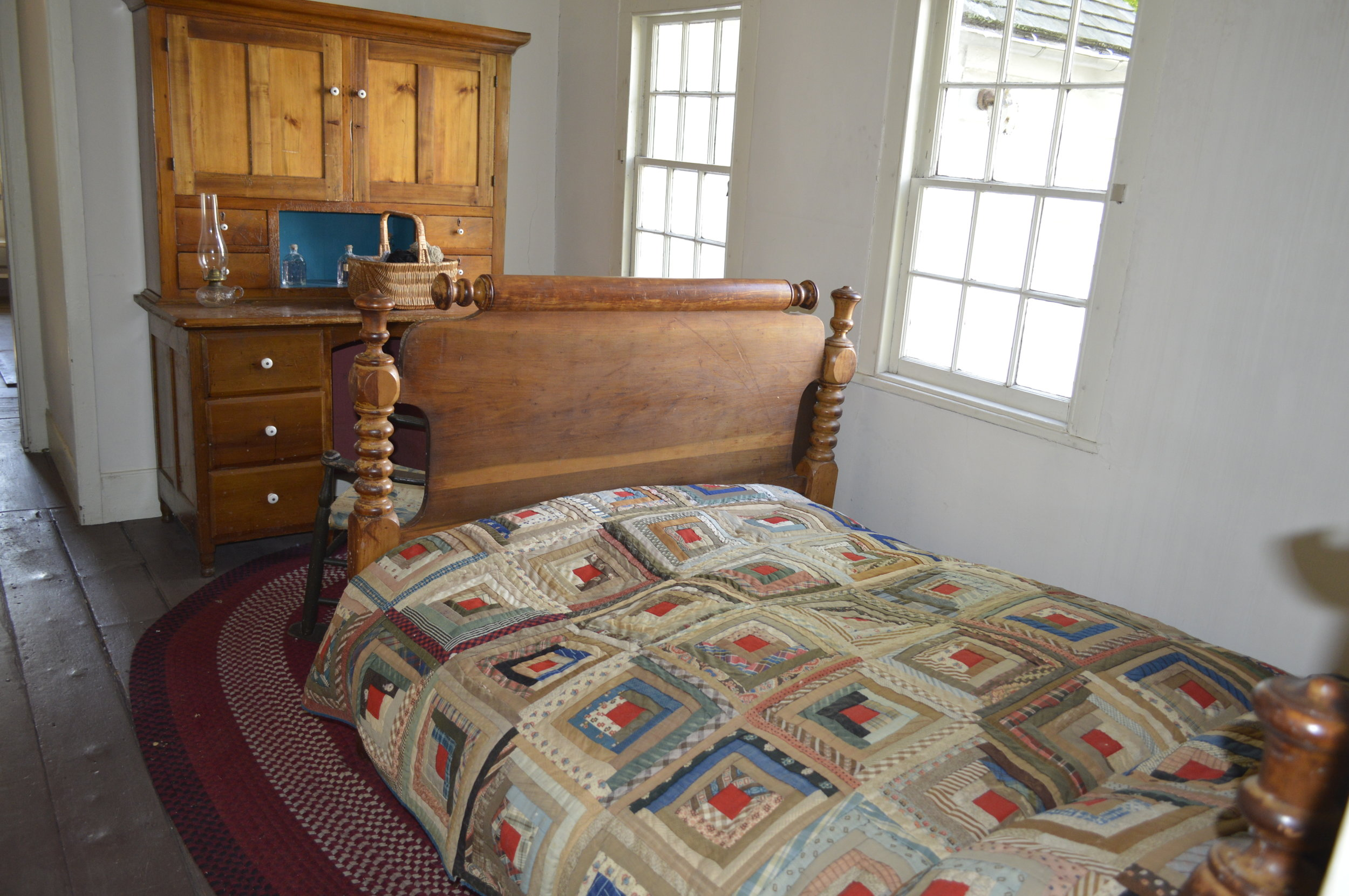 The grandmother's room is on the first floor. The bed foundation is a made of ropes and the quilt is handmade.