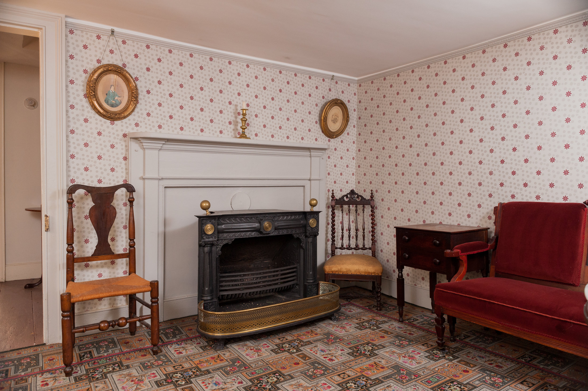 A Franklin stove kept theparlorwarm. It is one of several in the house.