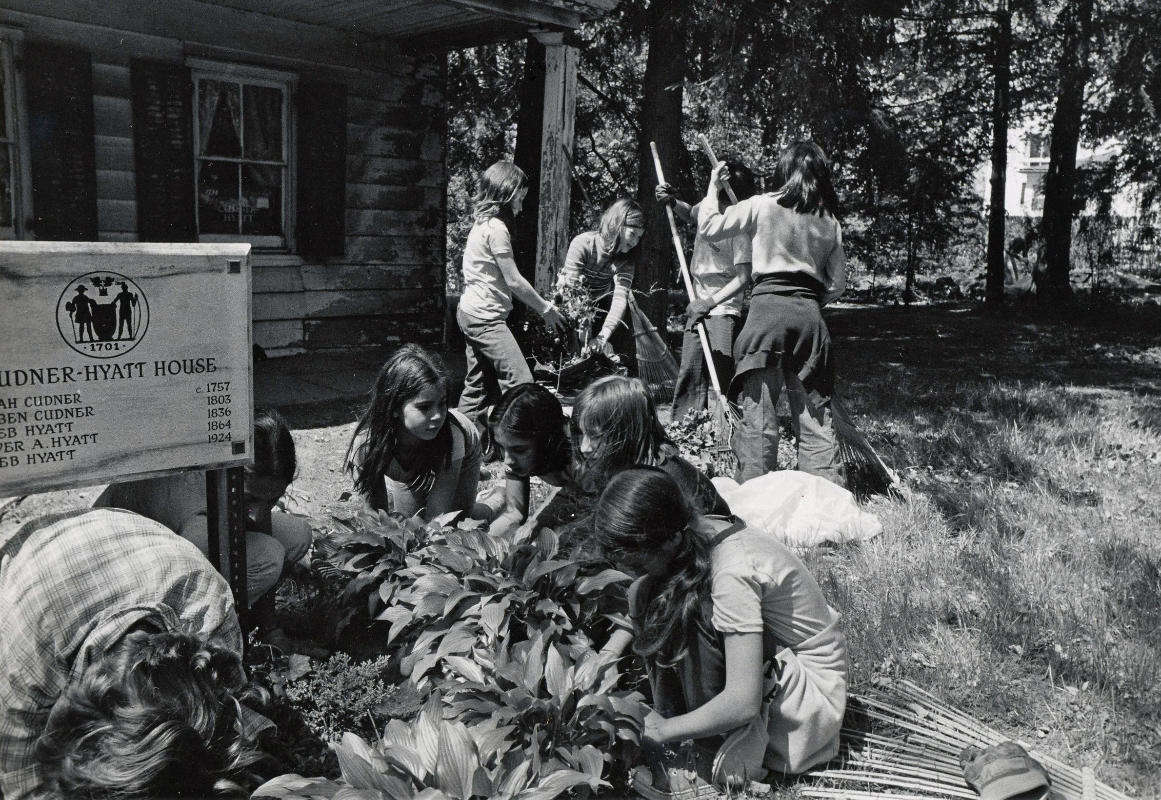 School children and volunteers helped clear the debris in the garden, 1975.