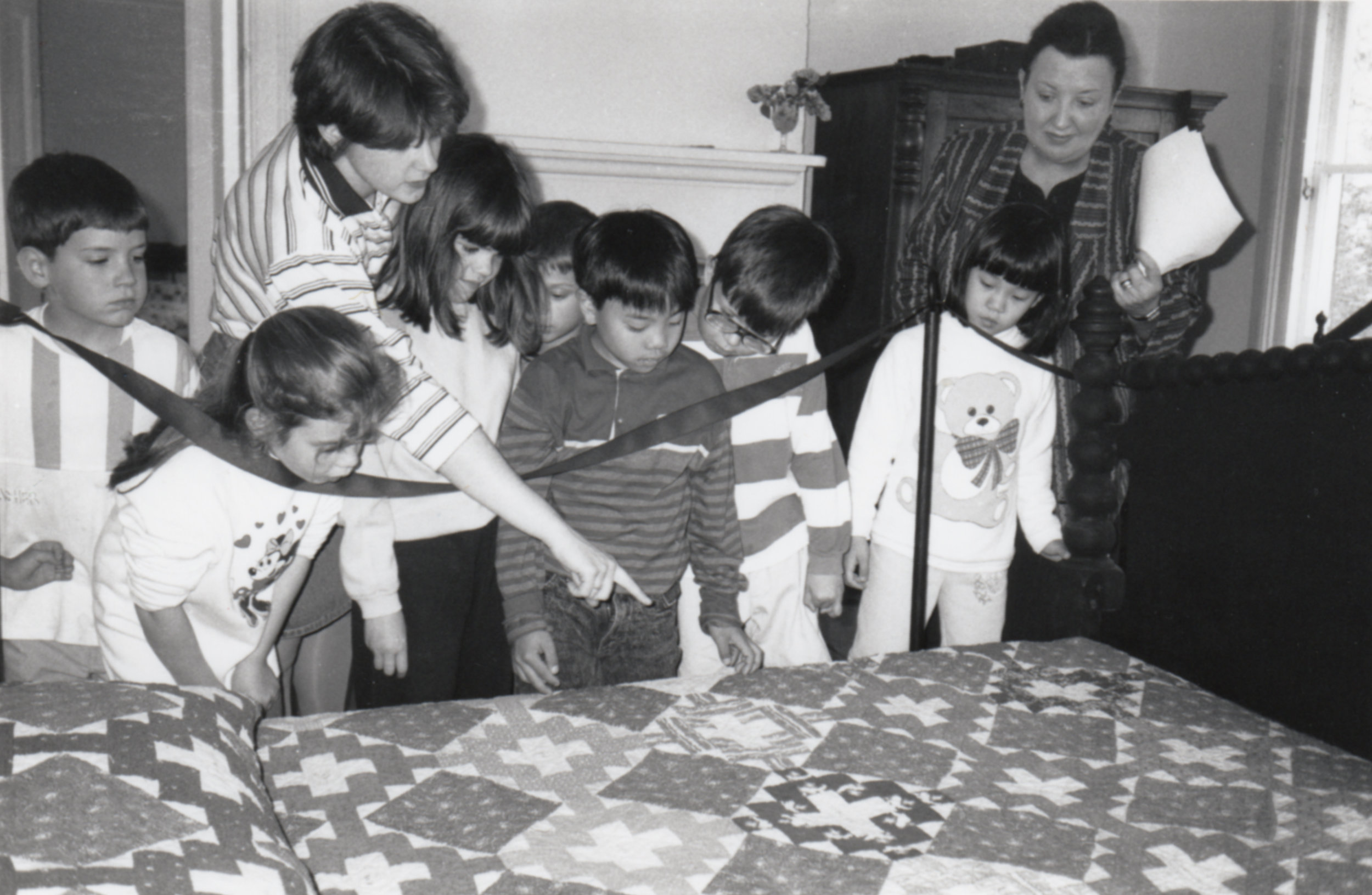 """Students learn about the 1849 """"Scarsdale Quilt"""" donated by Tykle Horowitz."""