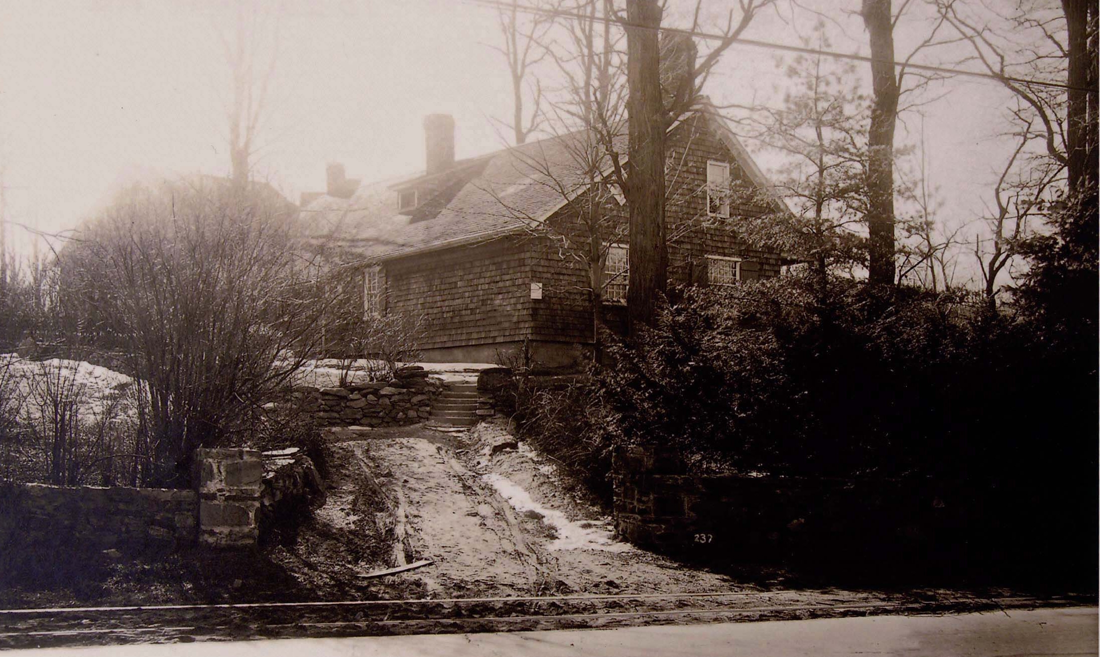 A rear view of the Underhill House, c. 1900s. Note the trolley car rails at the end of the driveway on Post Road.