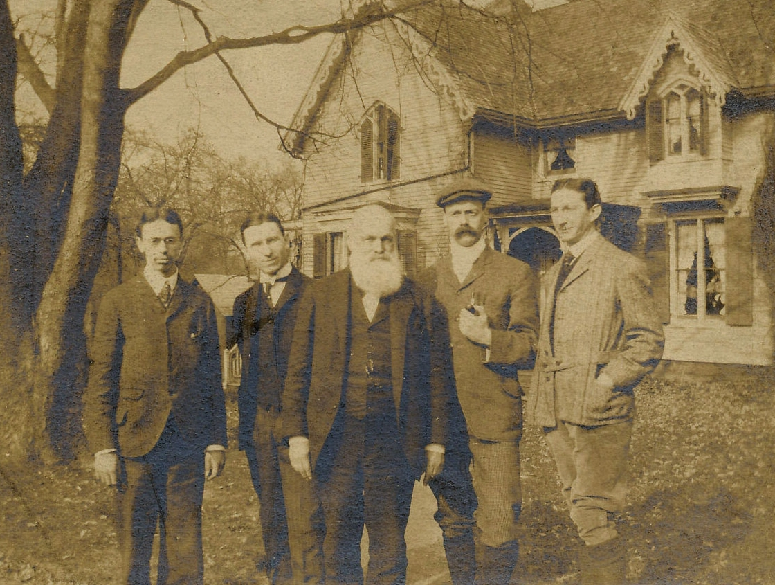 Charles Fleming and his sons in front of the Fleming-Hill House, date unknown.
