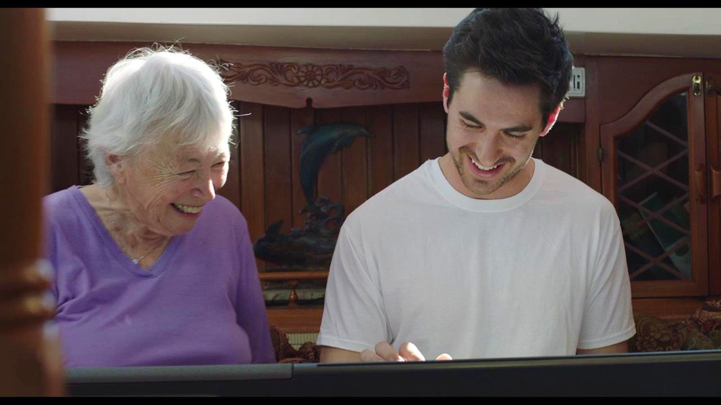 Both smiling at keyboard.jpg