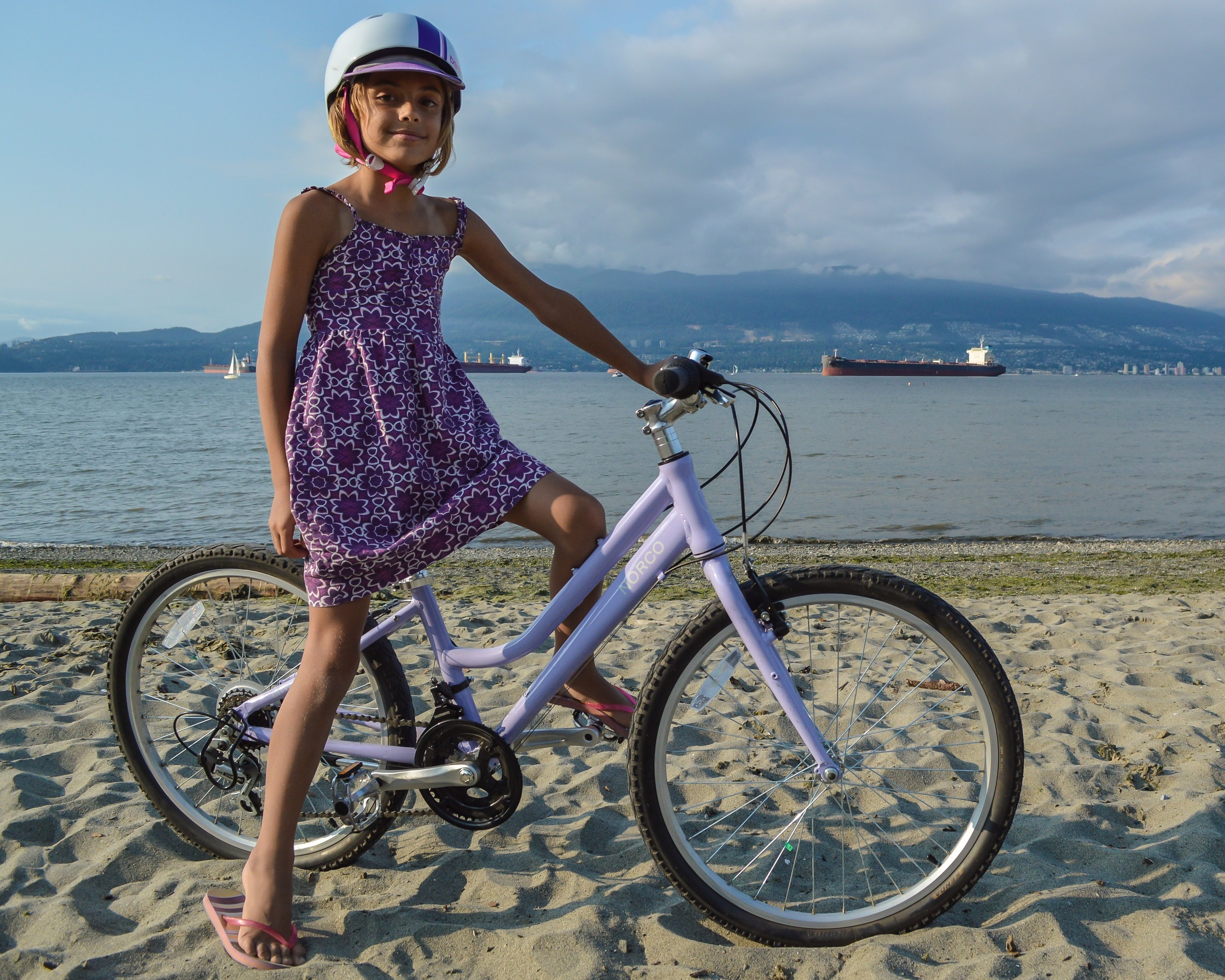 Even after riding many miles this summer, she's still happy to get on her bike again and again.