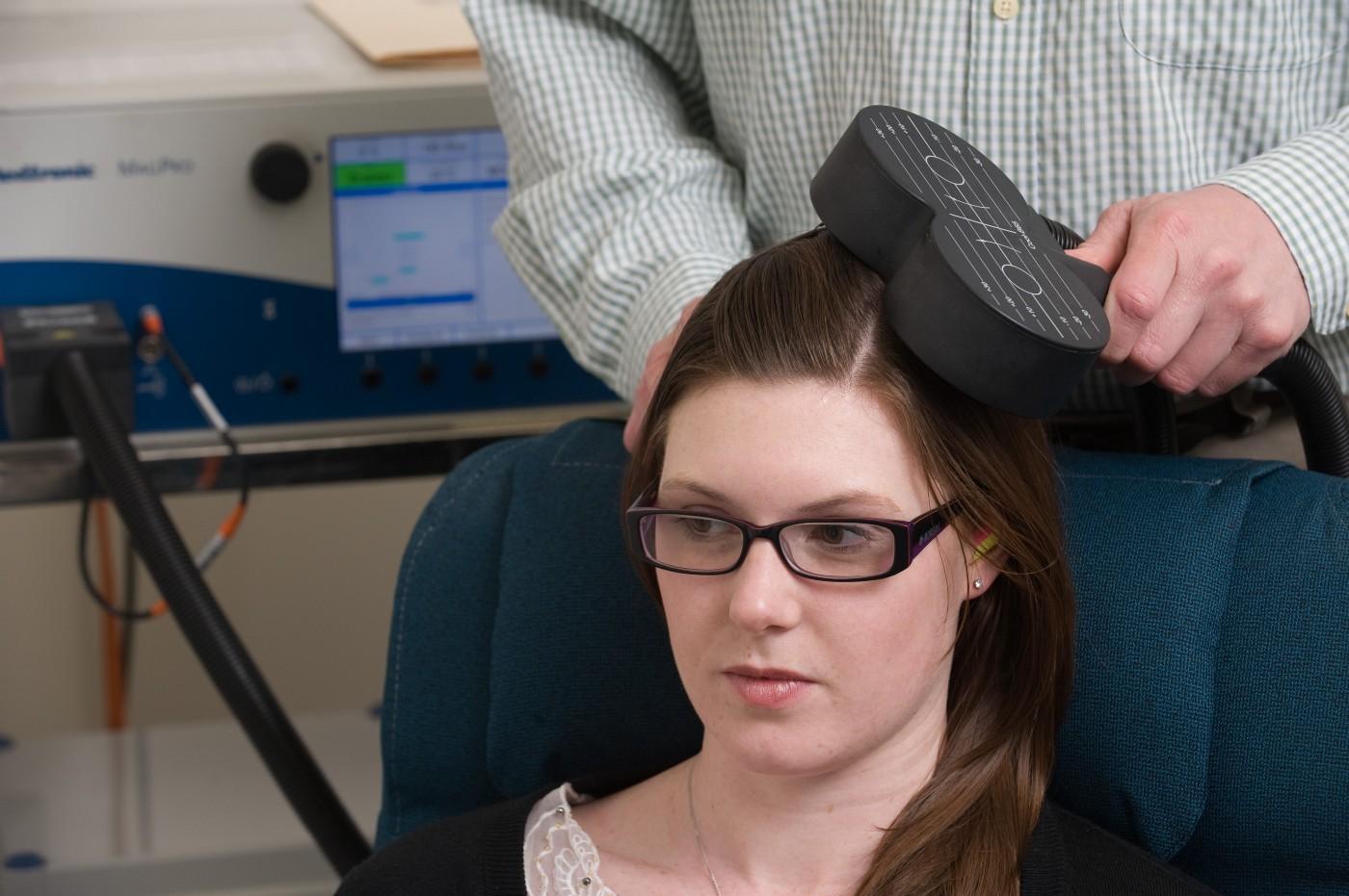 Transcranial Magnetic Stimulation (TMS) in action. (Photo credit: Monash University)