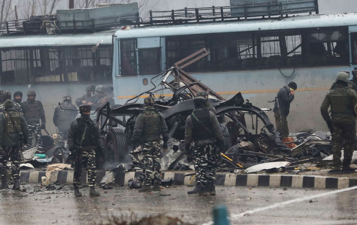 Indian security forces inspect the remains of a vehicle following a bomb explosion on a paramilitary Central Reserve Police Force convoy in Kashmir on Feb. 14, 2019. (Credit:  STR/AFP/Getty Images )