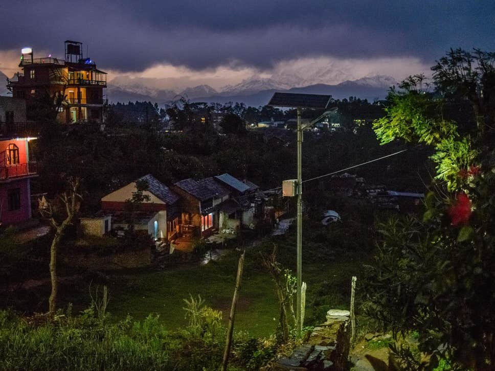 The lights go on in a small village in Bandipur, Nepal, as storm clouds gather in the distance behind the Himalayas.  Image credit:   Oleksandr Rupeta.