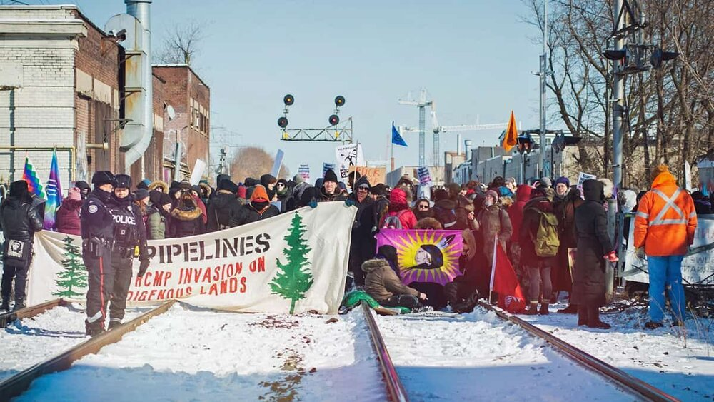Protesters block train tracks in Toronto on Feb. 8 amid demonstrations across Canada against the planned route of the Coastal Gaslink pipeline on the 11th February 2020. Jason Hargrove/Flickr