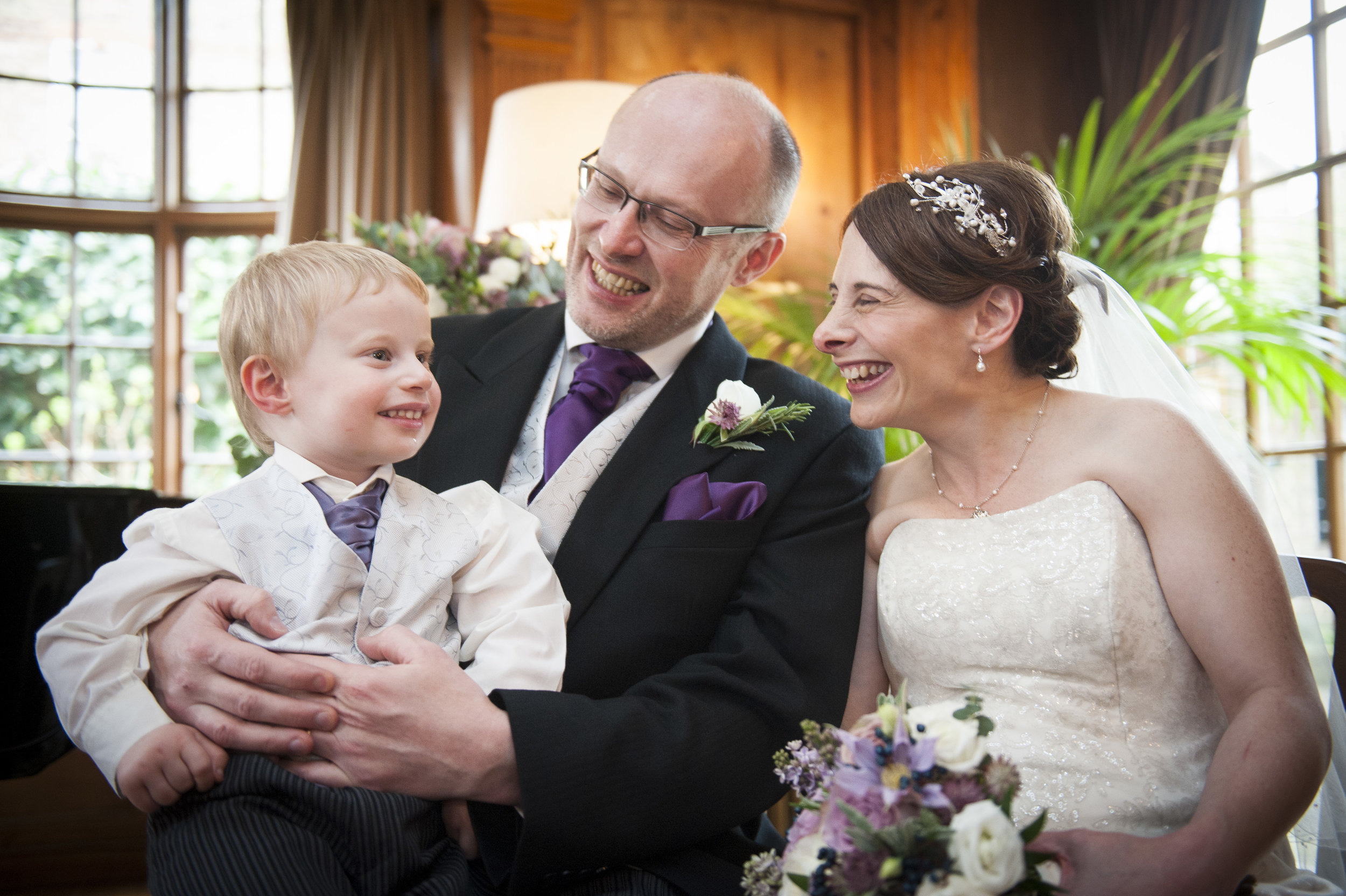 Jonathan and Geraldine - I chose Jason Pierce-Williams as our photographer for our wedding at Burgh House in Hampstead from a selection recommended to us by the venue. I had seen a simply beautiful photo on his website of a couple getting married at Burgh House. All I wanted was for him to achieve the same for us. However when I called him, I explained that we had a couple of issues that might affect his ability to achieve such good work. Firstly I was going to be 6 months pregnant by the time the wedding came around; and certainly no bride wants to look big in her wedding photos. Also there is a significant height difference between my husband and I, which always affects how we look in photographs together. Finally we have a 2 year old son that was going to be an integral part of the ceremony. However, who can predict what havoc a toddler might create just when you want him to be angelic. Jason wasn't phased by any of this, and took all of these issues completely in his stride. He achieved the most stunning photos for us, really capturing the essence of our little family on our special day. He also created our own beautiful, but completely natural version of the photo I had so admired, in the end quite different to the previous couple, extremely touching and most importantly very much us! Both my husband and I do not like pictures of ourselves and always shy away from the camera. However Jason has given us both an incredible memory of our wedding day; and stunning photographs of us together that we never thought would be possible. We are absolutely delighted with them. Thank you! Jonathan and Geraldine Fitzsimmons