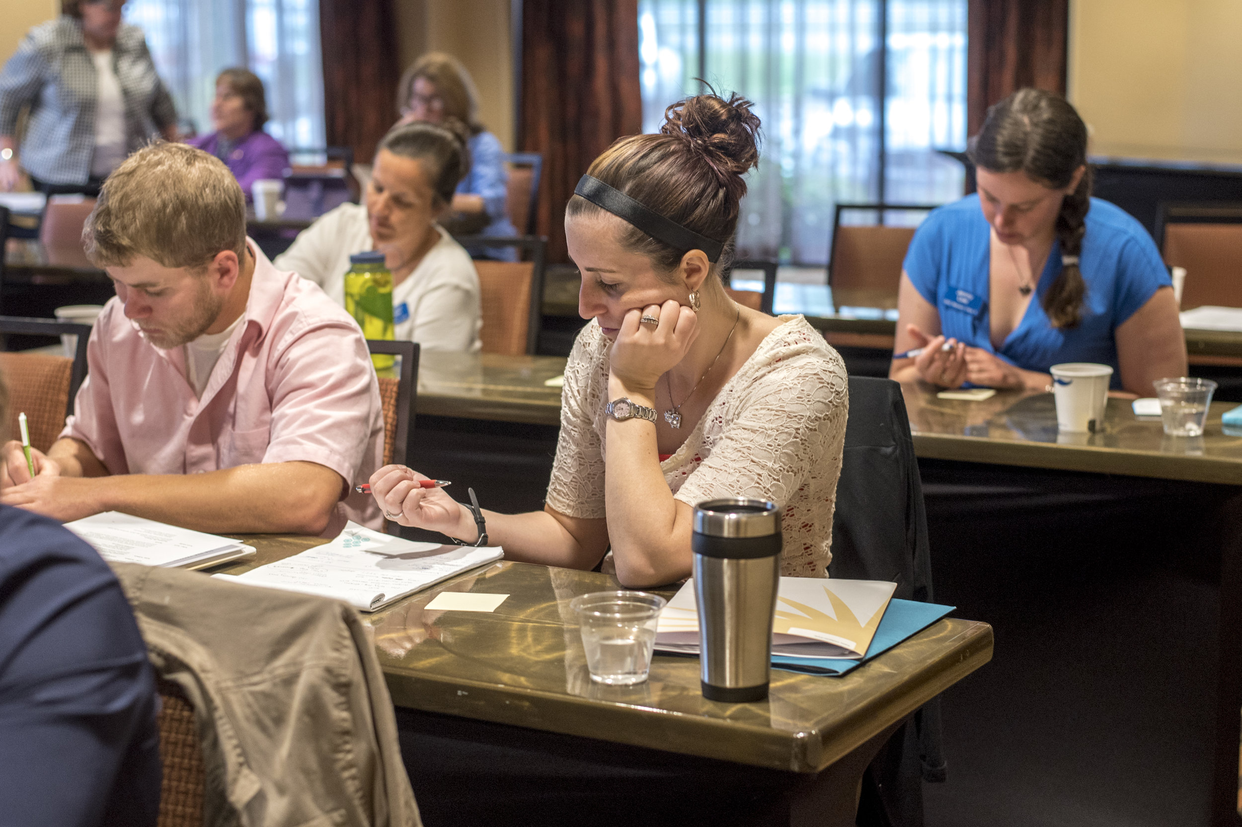 Taking notes during a meeting. Image by Edwin Remsberg
