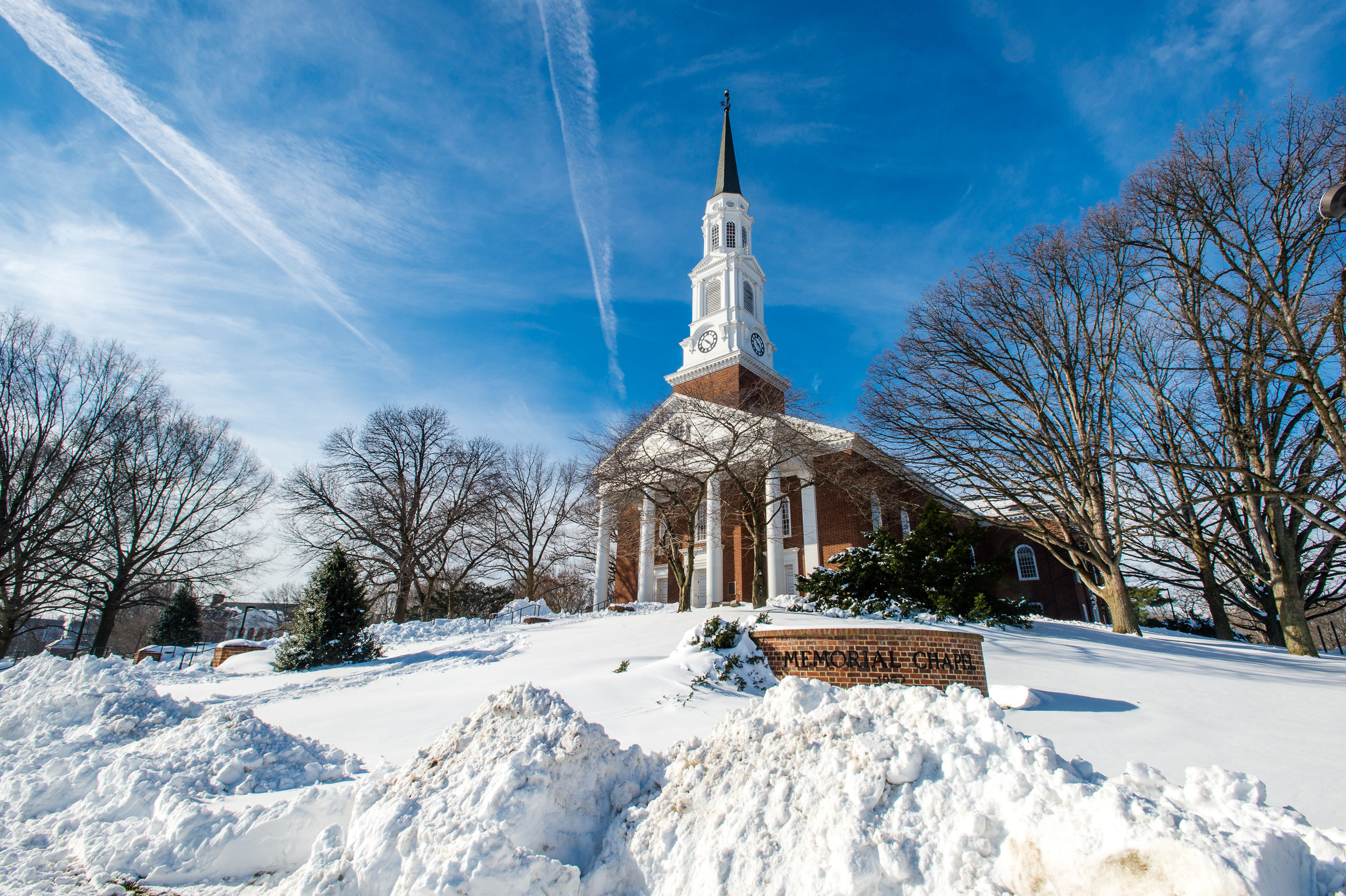 Photo by Edwin Remsberg. The photo shows the University of Maryland's Memorial Chapel covered in snow.