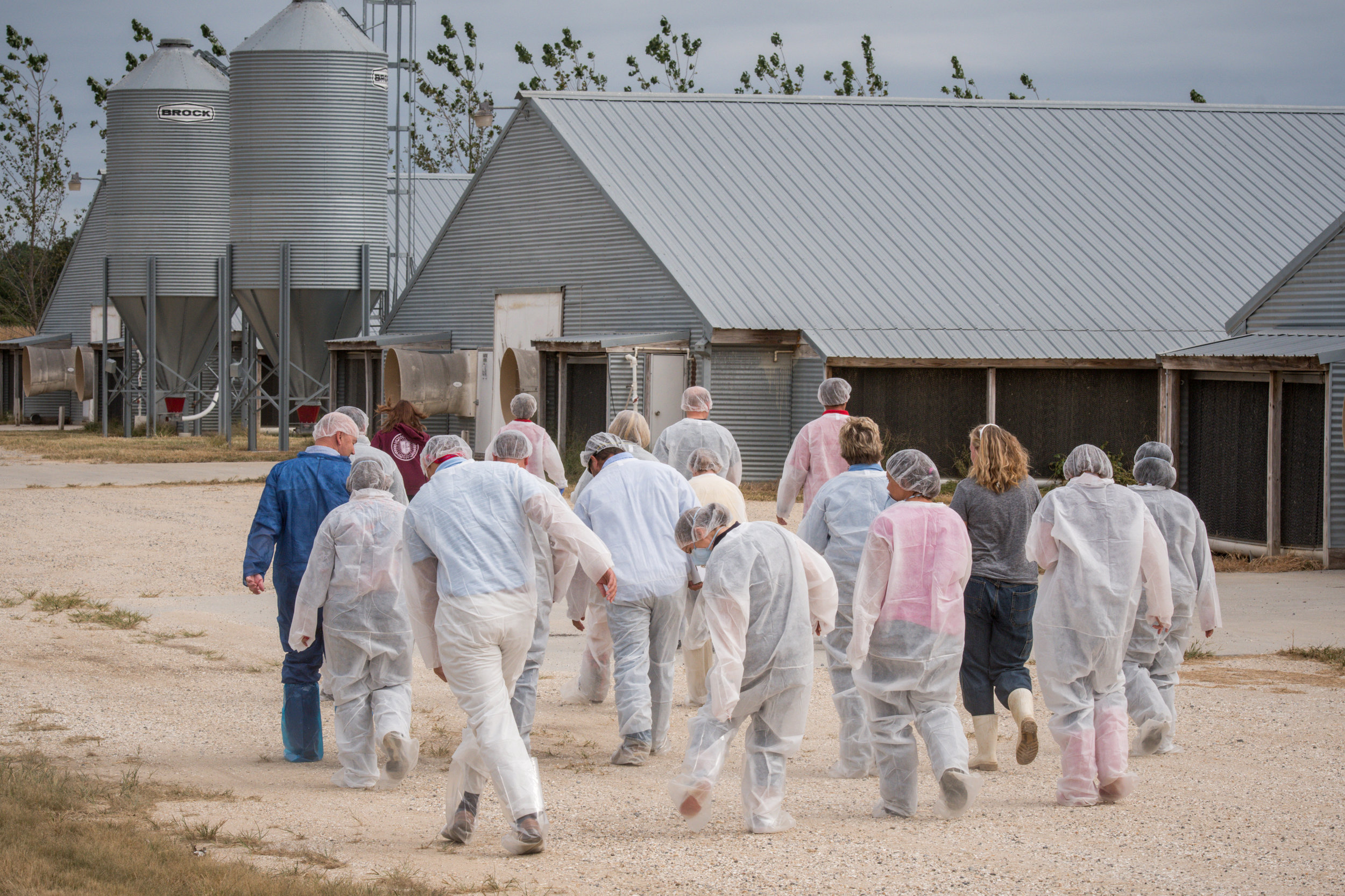 Image by Edwin Remsberg.  Image shows LEAD MD participants dressed to enter poultry houses in Maryland.