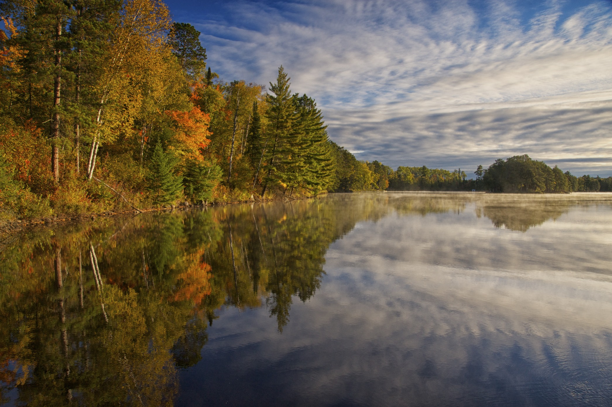 Image of farm lake surrounded by trees. Image by Jim Liestman