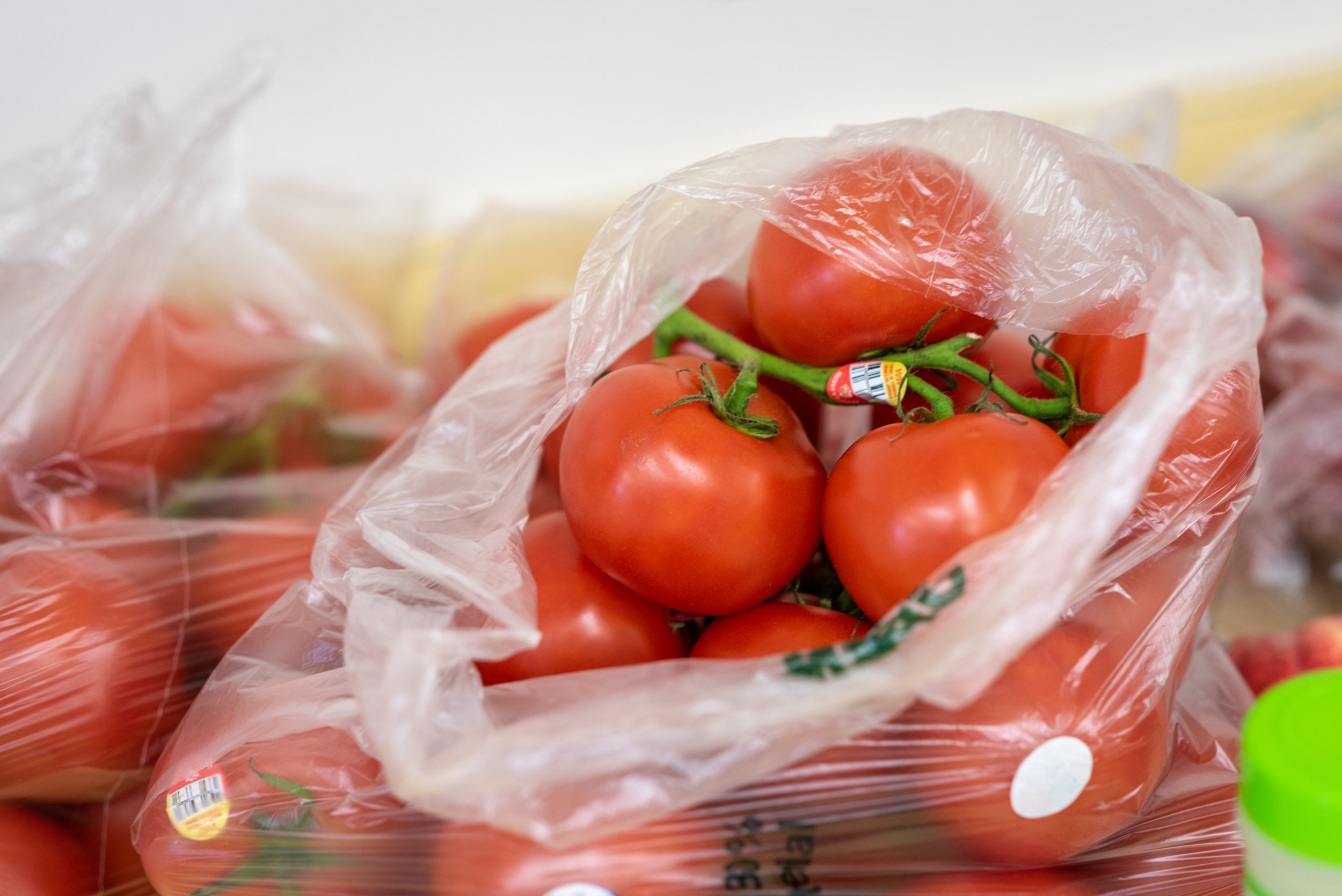 Image is of a sack of tomatoes.  Image by Edwin Remsberg.