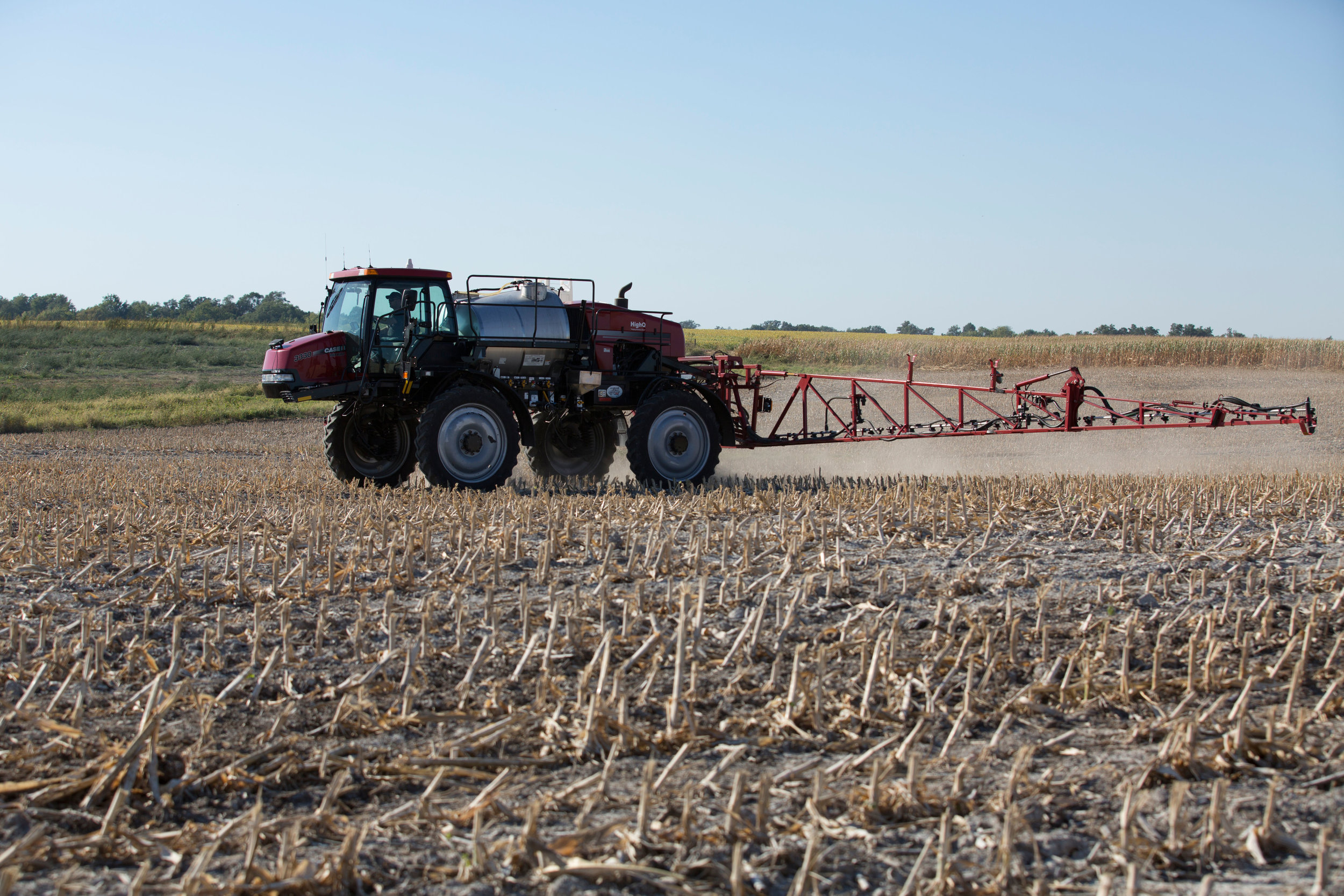Image of sprayer in field by United Soybean Board.