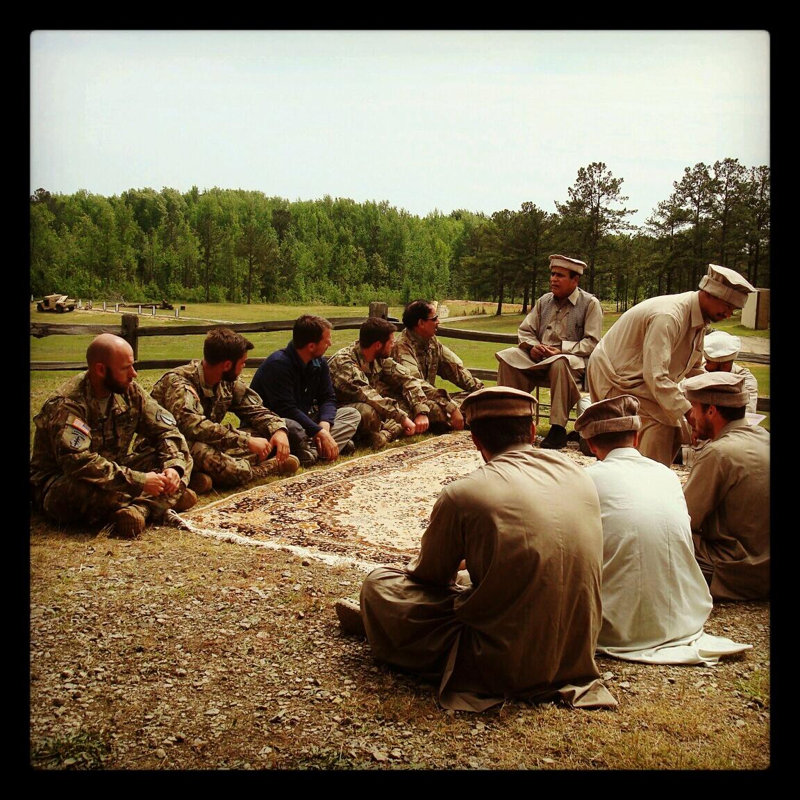 Demonstrating a 'shura' meeting, down to serving tea.