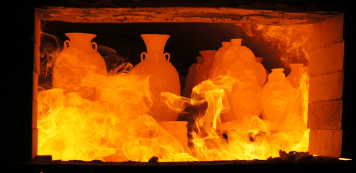 Pieces are fired inside the kiln.