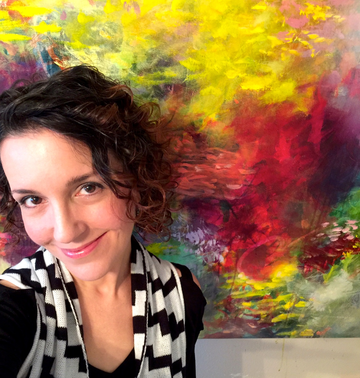 Paulette Insall, abstract painter working in her art studio in Portland, OR where she creates large abstract paintings inspired by nature (especially flowers) for home and corporate decor. Perfect for any decor style, whether it be modern contemporary or romantic traditional or transistional.