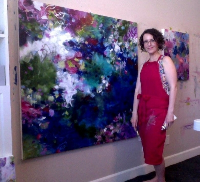 Paulette Insall at work on one of her large scale modern impressionist abstract paintings in her Portland, Oregon studio.