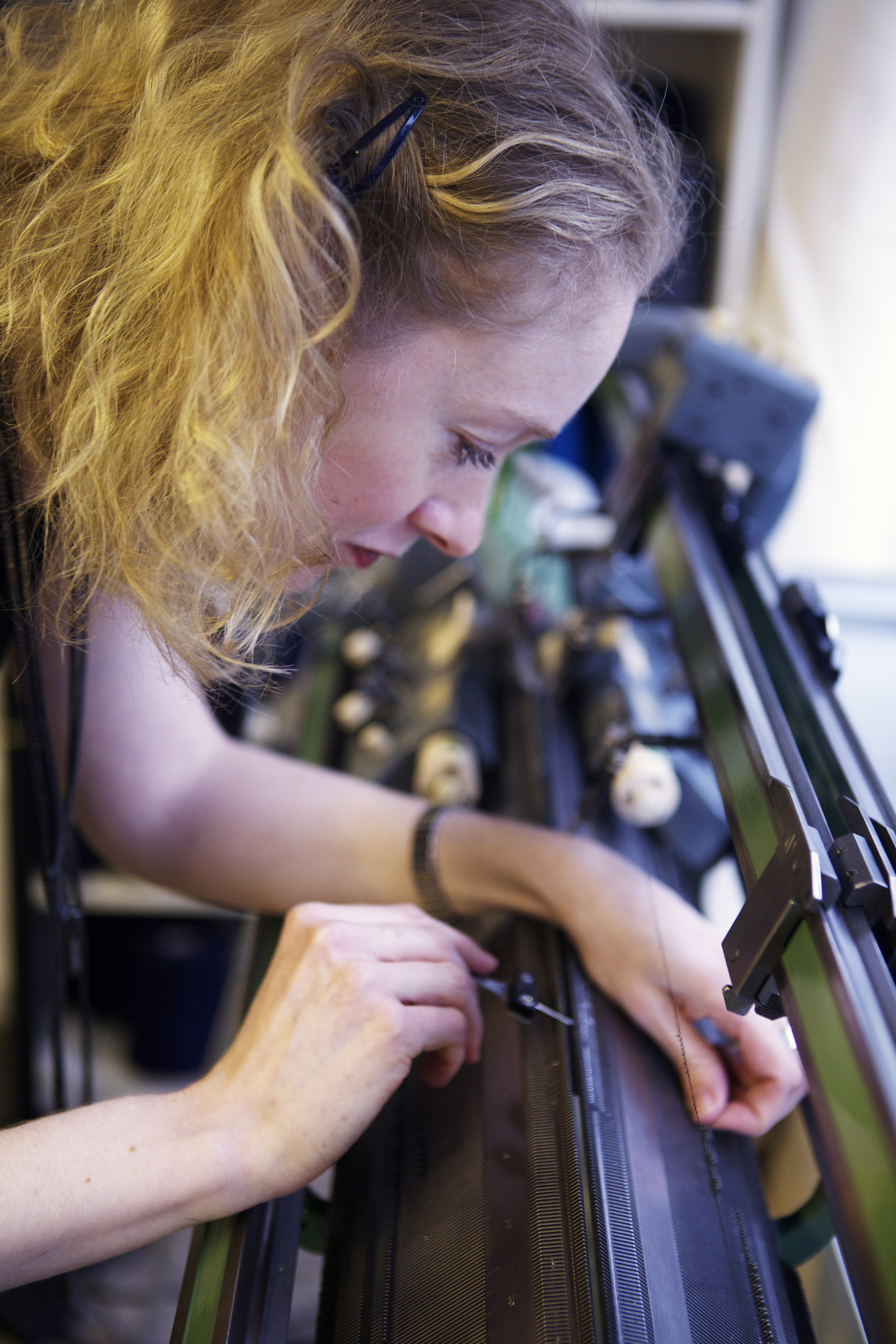 Layla at work on the 12 gauge vintage industrial knitting machine  Photography  Georgia Kuhn
