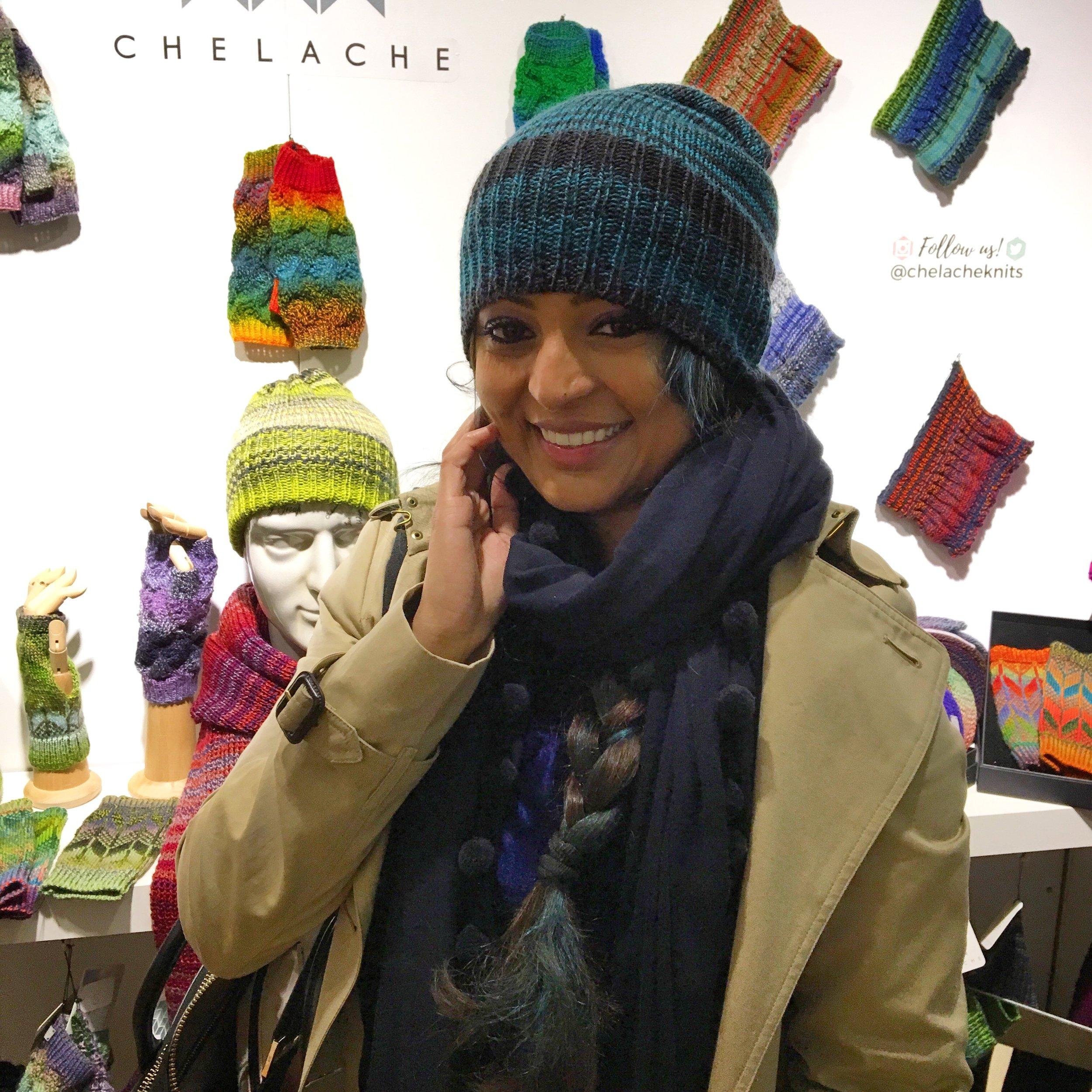 A happy customer wearing a CHELACHE beanie hat