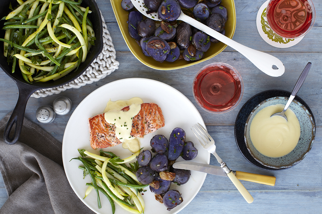 Pan-seared salmon with a dollop of Golden Citrus accompanied by roasted potatoes and green beans
