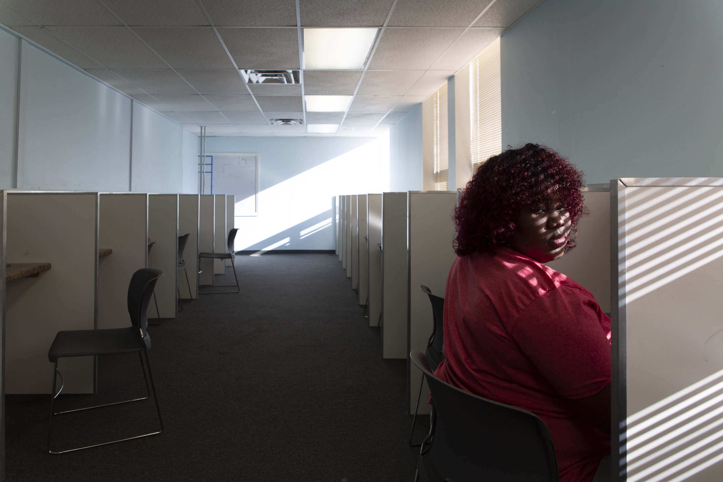 """""""I hate math,"""" Mikelah mumbled after completing a computerized test at Focus Learning Academy on Tuesday, Dec. 18, 2018. The school allows students to pace their own learning, which gives Mikelah the flexibility to raise Isaiah, but also lacks the structured classroom setting of a typical high school."""