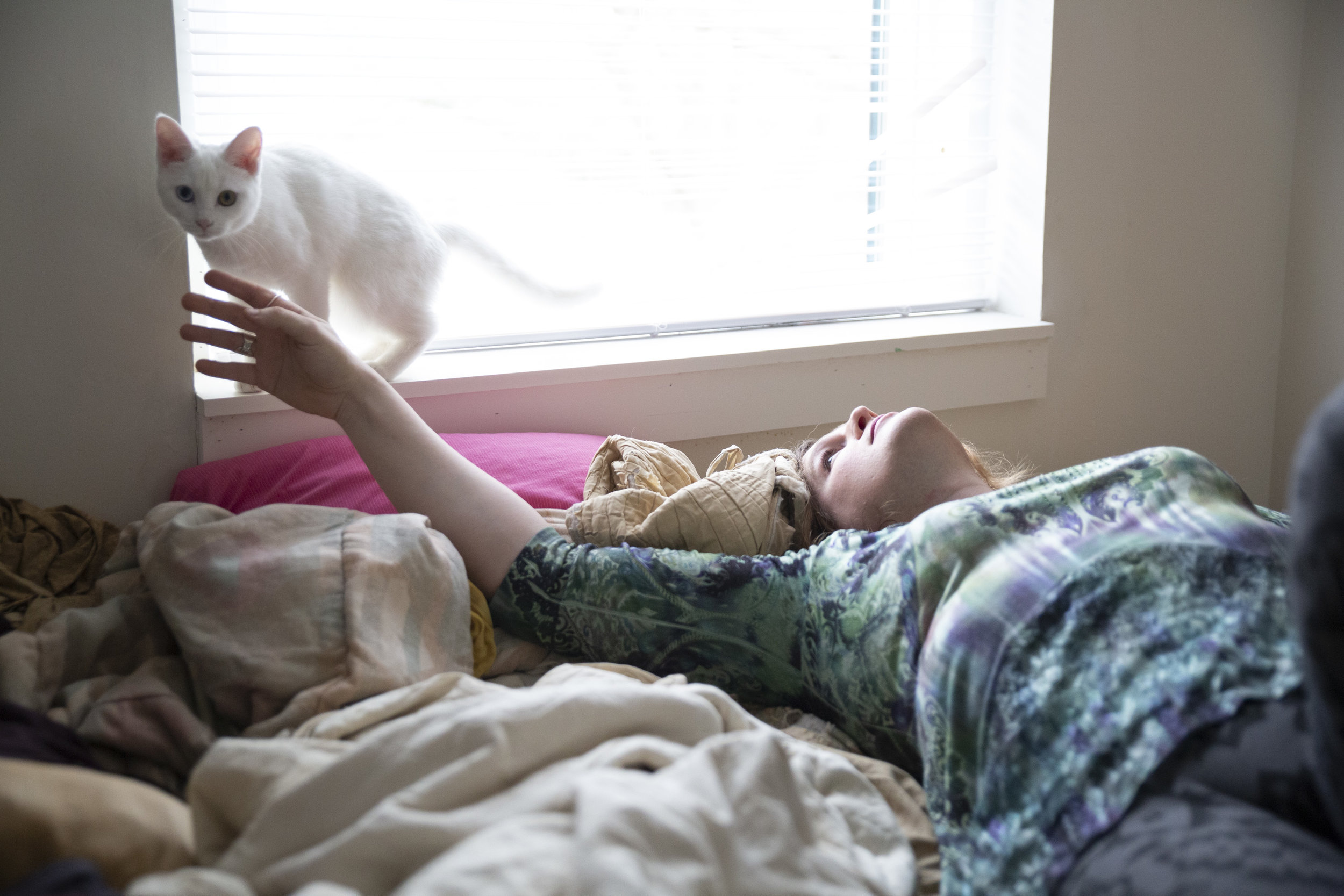 """""""My goal is to get to the point where I'm just Megan the woman, not Megan the trans woman. But right now that's a very distant dream,"""" Smith says at home in Athens with her cat, Mewtwo."""