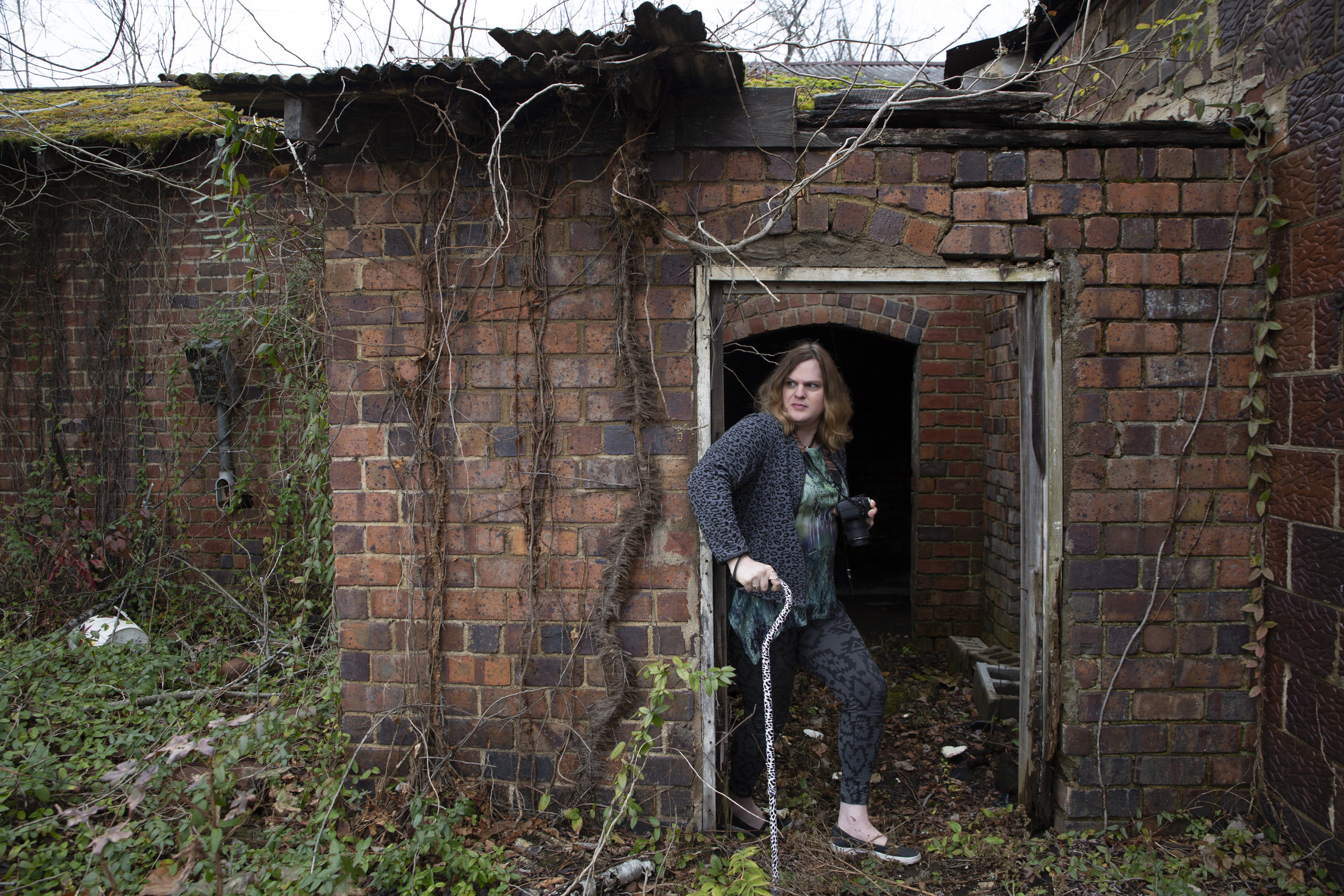 """""""What I like is broke-down places, spaces of decay, places that are abandoned by the rest of society,"""" says Smith of her favorite photography location in The Plains, Ohio. Smith is an artist and transgender activist who struggles with depression and suicidal ideation, as well as severe pack pain from a spinal injury that requires surgery."""