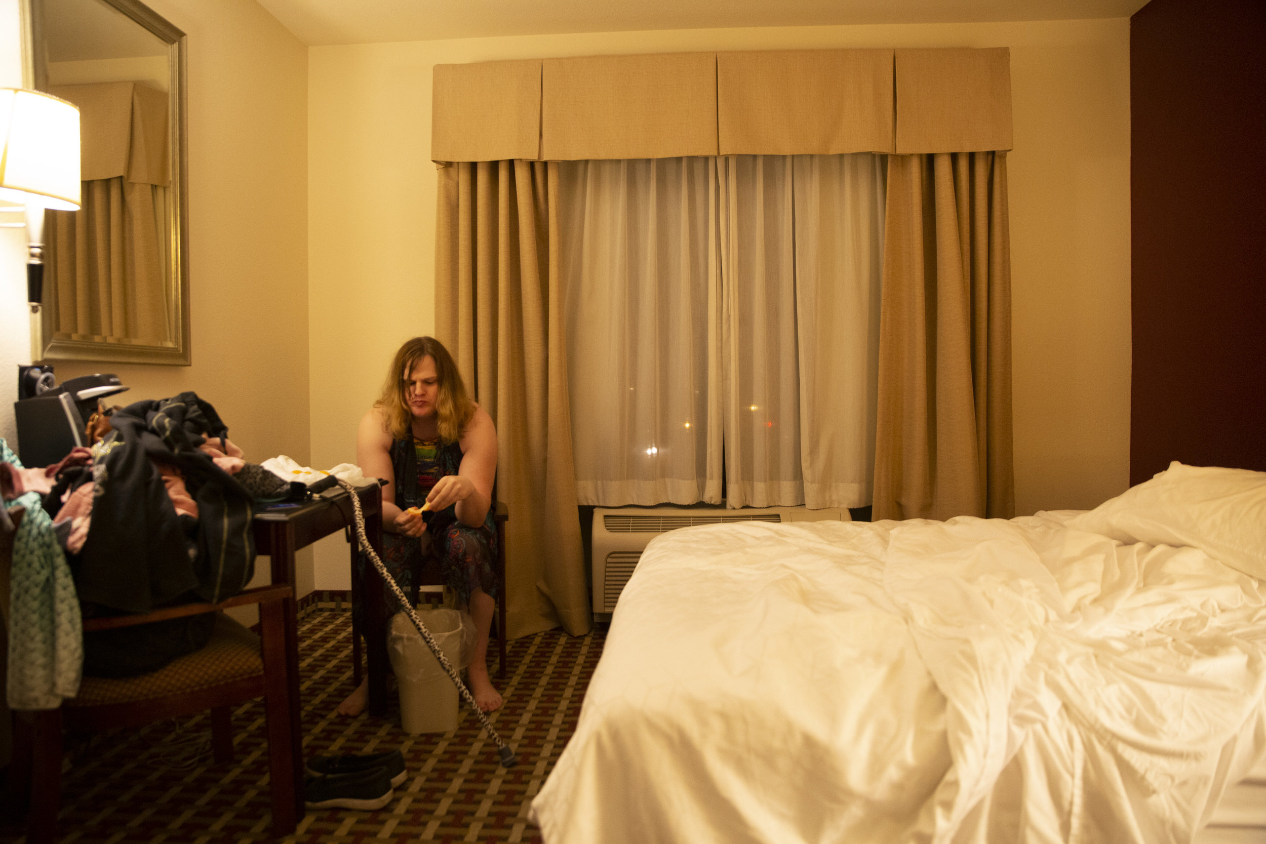 """Smith waits in the Holiday Inn Express the night before her spinal surgery. """"I have to accept that I'm going to spend my life alone, without a partner,"""" Smith says. Before coming out as trans, Smith was married."""