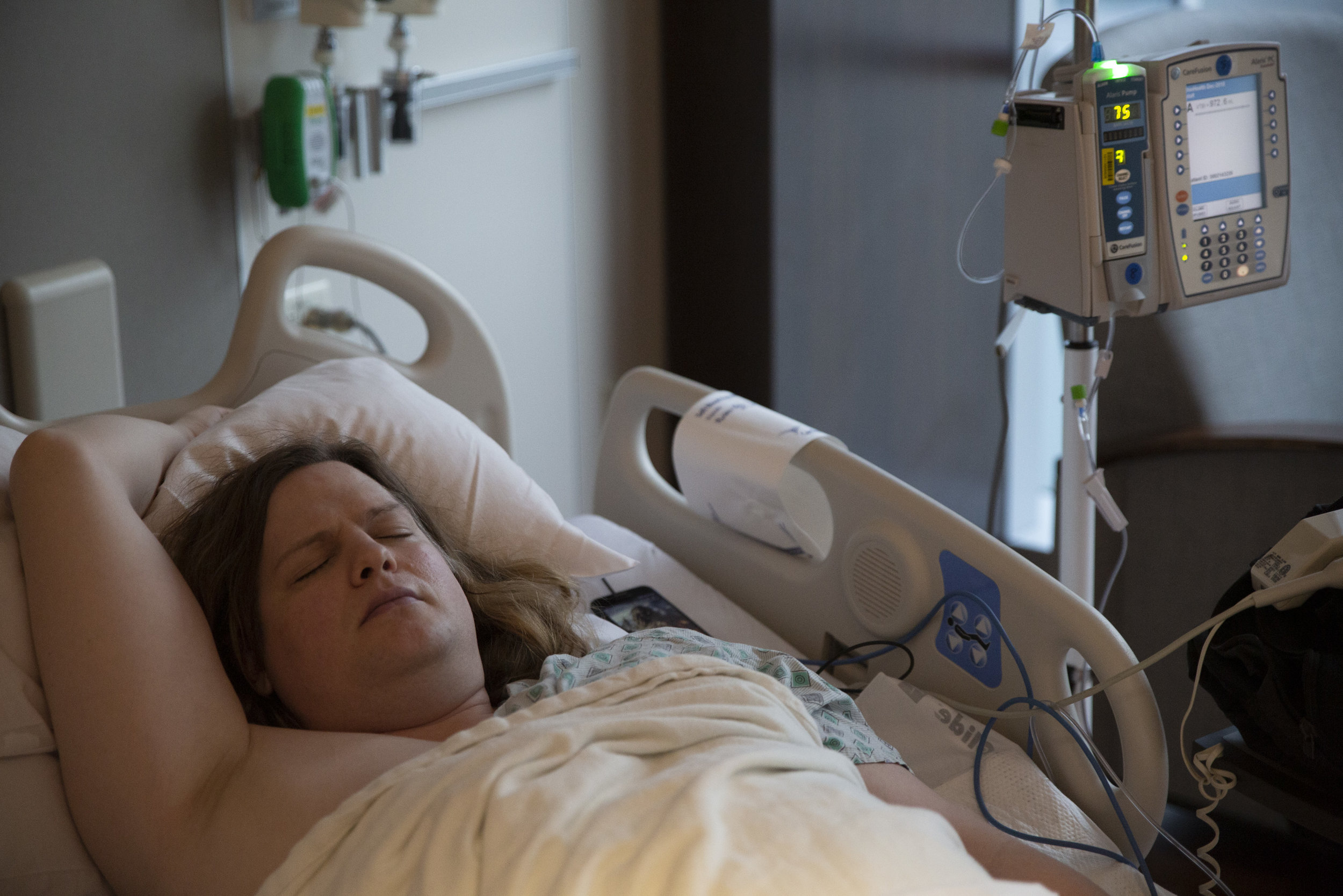"""Smith sleeps in a recovery room at Riverside Hospital in Columbus after successful spinal surgery. """"I just hope I can regain what's left of my life."""""""