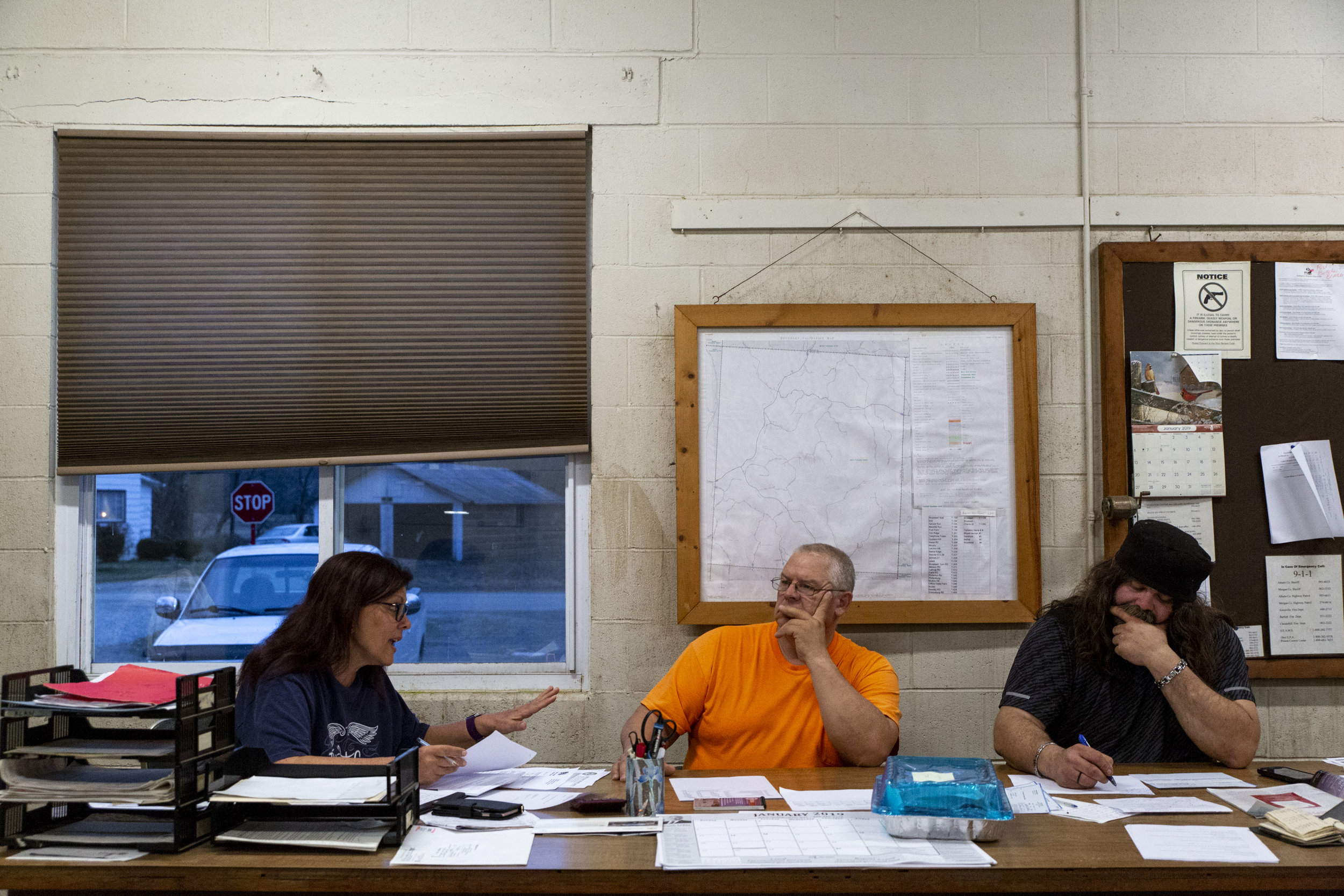 Bern Township Fiscal Officer Denise Tate and Trustees David Bennett and Alan Gilchrist discuss FEMA during their monthly meeting at Town Hall in Sharpsburg. As an unincorporated community, Sharpsburg is not governed by a municipal corporation and is, instead, administered as part of Bern Township.