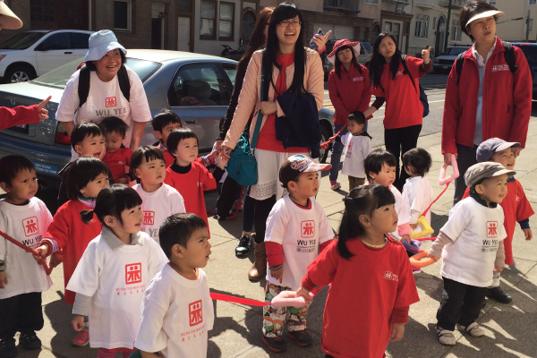 Students from Wu Yee went for a walk around the block to celebrate the Week of the Young Child.